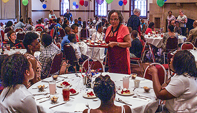 Fifth-graders celebrate with formal luncheon.